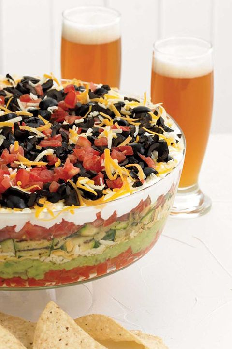 INGREDIENTS BY SAPUTO | Delight your family with this recipe for homemade 7-layer summer vegetable dip. Made with zucchini, avocado, peppers, tomatoes and black olives, it's the perfect seasonal appetizer idea. Top with cheddar cheese and Saputo Ricotta and serve with tortilla chips … then make sure to get some before it's gone!