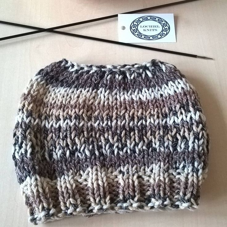 another messy bun hat, this one is a cotton and wool mix. Further details at www.facebook.com/lochielknits