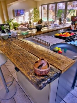 Nice counter bar top using reclaimed wood planks