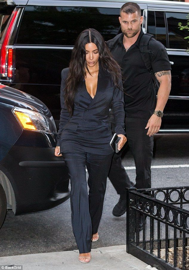 Kim Kardashian's bodyguard puts his hand near her bountiful backside #dailymail