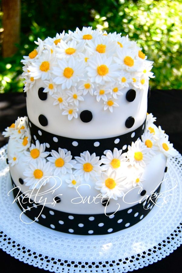 I love this!!  Daisy Cake  By: kellyssweetcakes  Chocolate buttermilk cake with a dark cherry buttercream. White fondant with fondant daisies and polka dot ribbon.  http://cakecentral.com/gallery/1686733/daisy-cake#