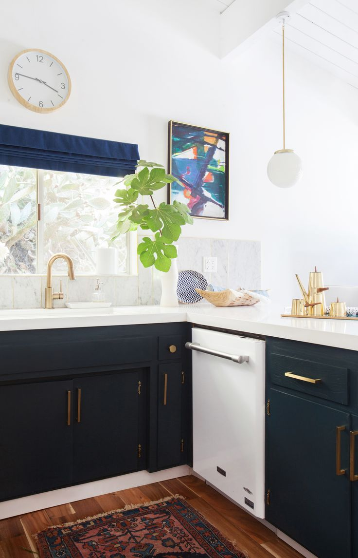 kitchen_after_emily henderson blue white brass appliances » Great space, comfy and sophisticated.