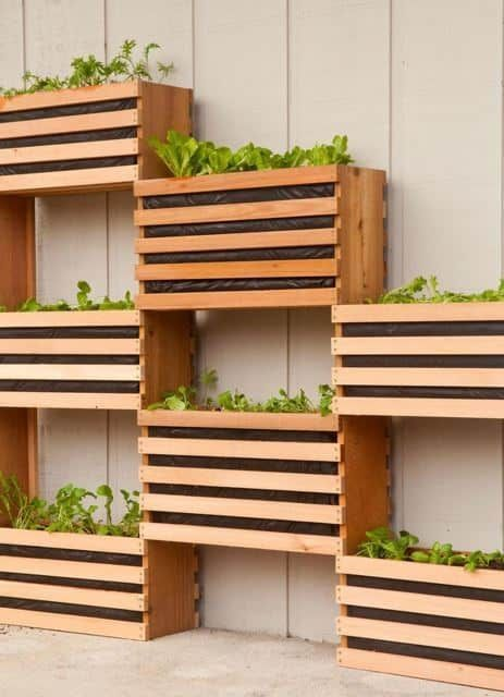 This vertical garden features plant boxes with slats. The slated containers give the space that extra rustic look with plenty of character. This is a fun concept in executing a vertical garden and you can easily adjust the size of these planters depending on the size of your outdoor area. You could even create mini slatted planter boxes for extra cuteness.
