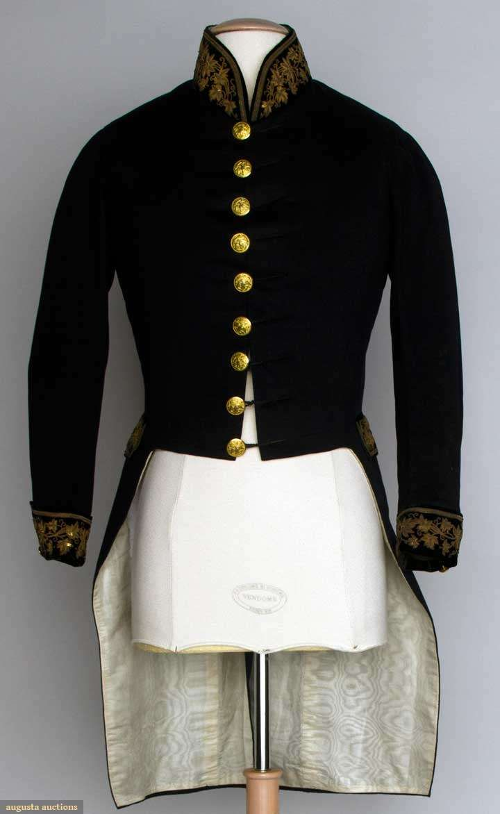 """AMERICAN COAT WORN AT FRENCH COURT, 1840 Black wool broad cloth tailcoat, velvet cuffs, pocket flaps & band collar all w/ gold embroidery, gold buttons stamped w/ eagle & surmounted by band """"E Pluribus Unum"""", ivory silk moire lining, Ch 36"""", CF L 19"""", CB L 36.5"""", (minor moth damage & light stains on back) very good. Provenance William Shimmin, Mass."""