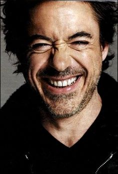 laughing - I have loved Robert Downey Junior forever & he just gets more wonderful & sexier by the year! He is one of the most talented actors of my generation, & the fact that he's faced his demons & returned stronger than ever just makes him that much more confident in his own skin!
