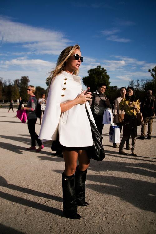 Emilio Pucci Cape, La Mania skirt, Givenchy boots, Chanel bag and Miu Miu sunglasses.