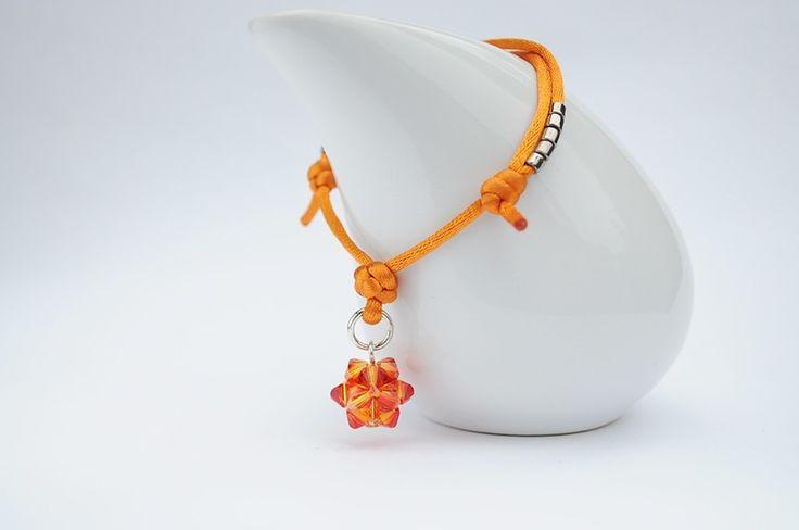 Satin cord bracelet - bransoletka wykonana jest z pomarańczowej satyny  i ozdobiona kulką z kryształków SWAROVSKIEGO - BICONE - FIREOPAL. Dodatkową ozdobę stanowią japońskie koraliki MIYUKI w kolorze srebrnym.