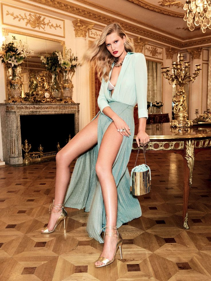 Flaunting some leg, Toni Garrn wears Elisabetta Franchi top and skirt with slits