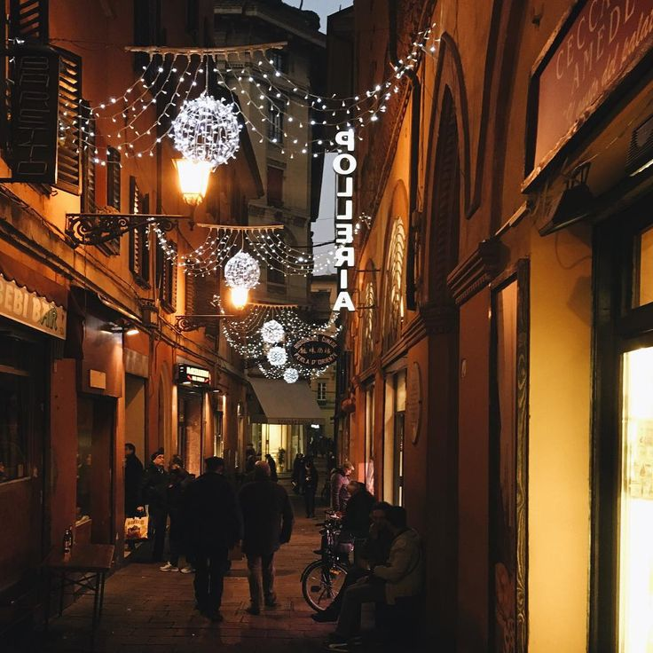 """""""How lovely is to walk in the old market area of #Bologna. Make me always feel so calm and welcome (and with #Christmas lighting even better)"""" - Instagram by valeriamoschet"""