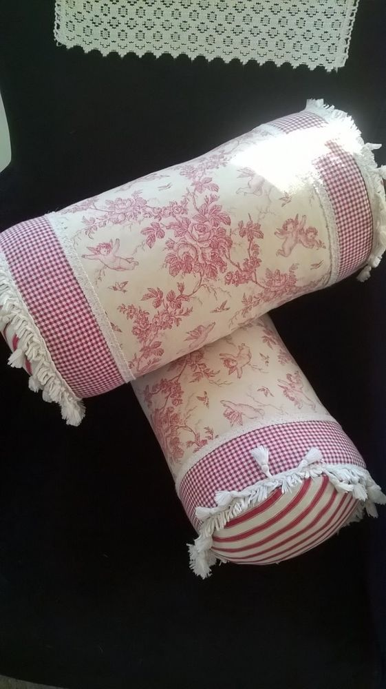 Beautiful shabby chic feather filled toile de jouy bolster cushions with tassels