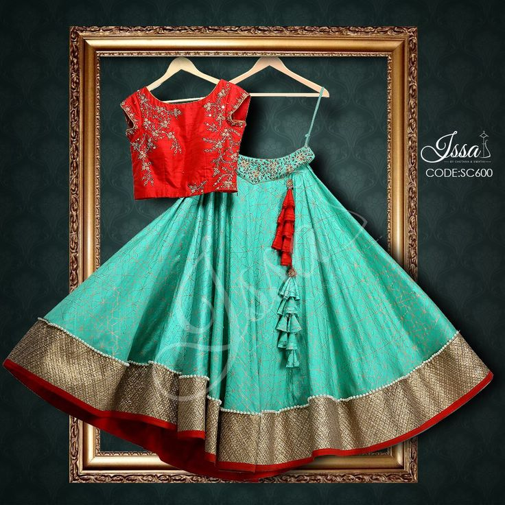 SC600: Red and sea green crop top lehenga!!!! To order please call/ WhatsApp on 9949944178 or mail us @issadesignerstudio@gmail.com 13 June 2016