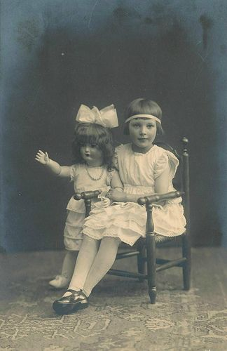 1920's girl with large doll