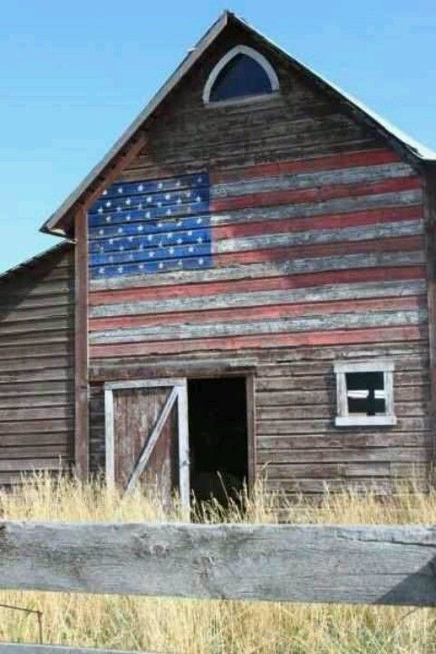 Great old barn with a weathered American flag painted on the side. Very patriotic and very country, rustic