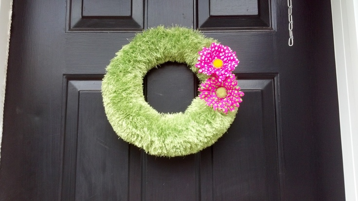 """I was originally going to make this wreath for easter but I ran out of yarn and by the time I found more it became a """"spring wreath"""" instead!  Very easy just buy a green foam ring big or small whatever you would like.  Then grab some fun fur color lime, I used about 3 skeins and just wrap and wrap until you cant wrap anymore!  I then added these super cute daisies which I thought were the perfect touch I just stuck them right into the styrofoam!  Hope you enjoy!!"""