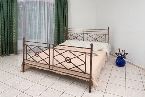 In the Letizia Bed, mix of geometric forms comes together to create a balanced design that is perfect for modern décor. The symmetrical design includes squares and rectangles divided by bold diagonals into a pattern of triangles and diamonds. The headboard is finished with two strong vertical poles on either side. This exquisite iron headboard is available in many different colors to complement your color palette and the look of your décor.