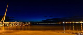 Night time at Salou Pier, learn how to travel the world for free www.livealifeofyourdreams.com/beachfreedom