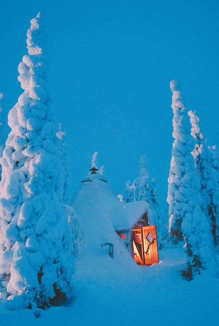 Blue sky, blue moment in winter. Winter sunset view, winter wonderland nature photography. Taking a break by the fire.