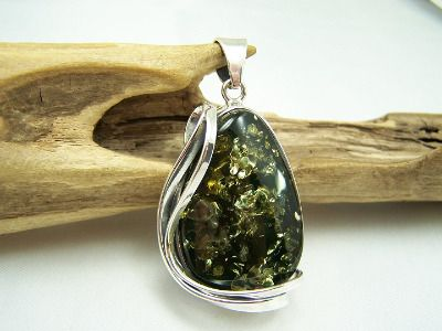 Unique big green Baltic amber pendant in sterling silver modern mount with ribbons.
