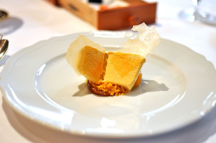 """Butterscotch semifreddo -- drizzled with Kalahari melon seed """"agrumata"""" (oil), plated over """"sbrisolona"""" (a crumbly cake made from polenta and almonds) and a small mound of semi-sweet """"milk jam"""" (dulce de leche.)"""