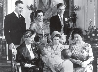 Days Of Majesty: The Royal Christening of Princess Anne, Music Room, Buckingham Palace, October 21, 1950-Princess Alice, Countess of Athlone, Princess Elizabeth holding Princess Anne, Prince Charles with back to the camera, Queen Mother (grandmother and godmother); standing-Earl Mountbatten (great-uncle and godfather), Princess Margarita of Hohenlohe-Langenburg (paternal aunt and godmother), Hon Andrew Elphinstone (cousin and godfather)