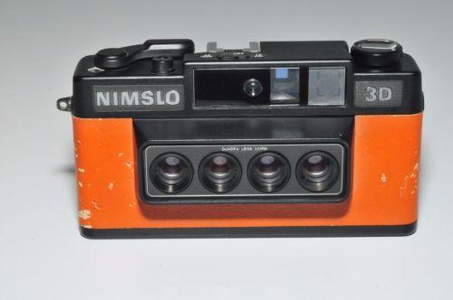 NIMSLO-35MM-3D-Camera-in-tan-brown-faded-orange-looks-tan-to-me