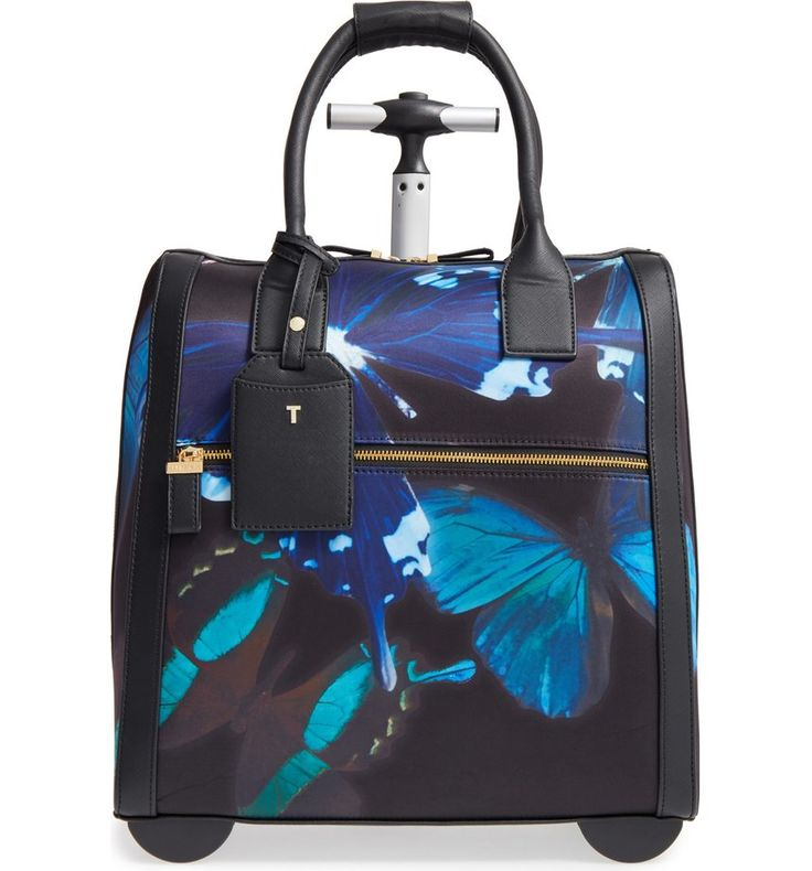 Traveling is made easy with this cute and stylish Ted Baker travel bag detailed in bright blue butterflies.