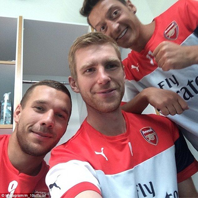 They're back! German World Cup-winning trio (left to right) Lukas Podolski, Per Mertesacke...