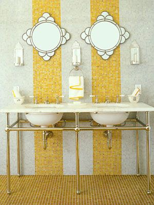 Striking Bath    Glass tiles from Waterworks line the walls and floor in the guest bathroom of this California home by designer Jay Jeffers. The amber stripes break up the space and add a note of whimsy. The pair of sinks are from Waterworks. Deco mirrors from Pottery Barn.
