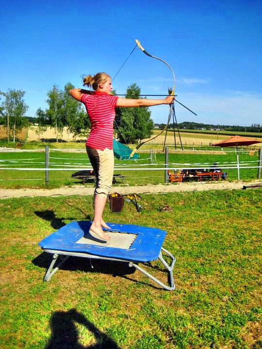 Archery training on trampoline for mounted archers