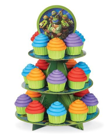 "Serve some turtle treats on these Teenage Mutant Ninja Turtles Cupcake Stand! Includes 1 cardboard cake stand that has 3 tiers and will hold 24 cupcakes. The stand measures 11.75""""W x 16""""H. Some asse"