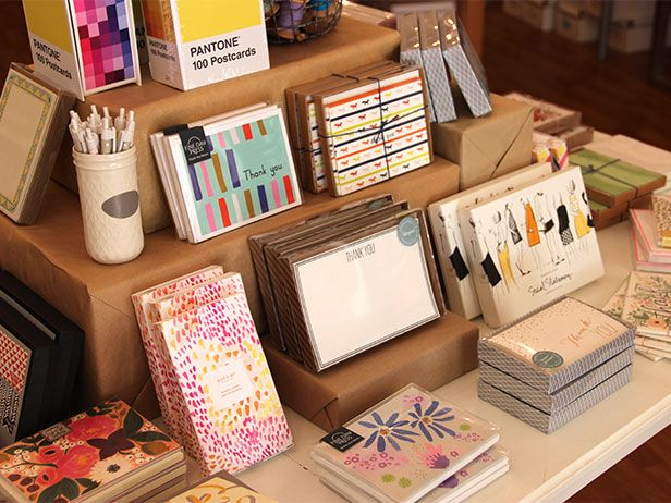 Wrap boxes in kraft paper and stack them in a pyramid for a simple and powerful stationery display.