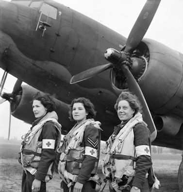 Corporal Lydia Alford (centre) was the one of three women known as the Flying Nightingales to land in a battle zone after D-Day. Alford was a WAAF Air Ambulance Medical Orderly with No. 233 Squadron RAF and flew on the first RAF transport aircraft to evacuate the wounded from the Normandy battlefields. On 13 June 1944, three of the squadron's Dakotas Mk. III, with a Spitfire escort, had the honour of executing the first Allied transport flight to land in France since the invasion ~