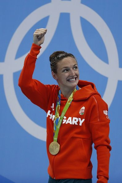 #RIO2016 - Best of Day 1 - Hungary's Katinka Hosszu celebrates on the podium with her gold medal after she won the Women's 400m Individual Medley Final during the swimming...