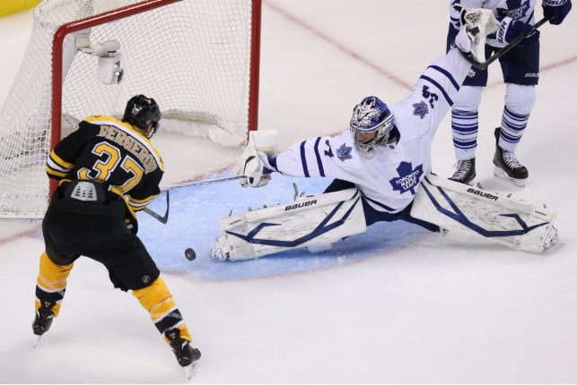 Somehow James Reimer stops this Patrice Bergeron shot as the Toronto Maple Leafs play the Boston Bruins.