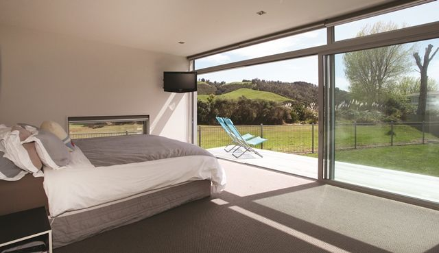 The separate master suite overlooks a neighbouring reserve.