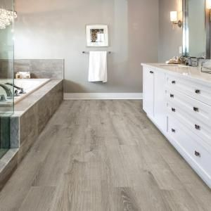Append A Stylish Look To Your Home By Choosing This Durable Allure ISOCORE  Wide Smoked Oak Silver Luxury Vinyl Plank Flooring.