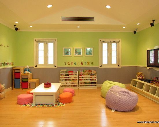 Photo only: simple, open playspace with options.  Cute frame behind flat tv...
