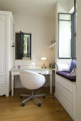 I like the use of this tight space. Window light. Simple work area. Comfy window seat.