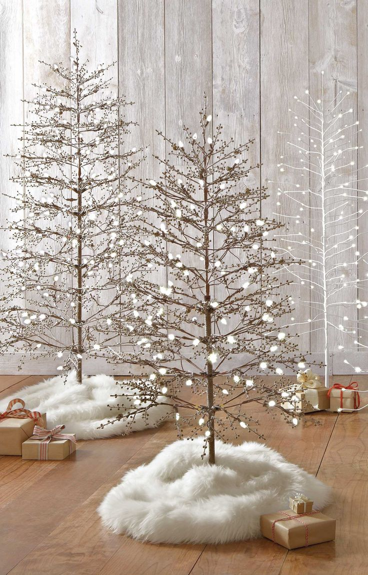 Transform your living room into a snow-covered forest with these pre-lit stick trees from the Martha Stewart Living Holiday Collections!