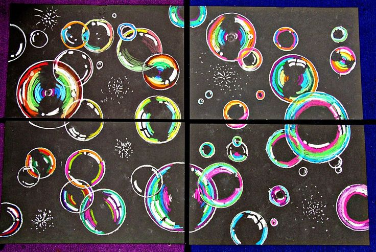 Bubbles:  1. First students traced as many different circle shaped objects I could fine!! 2 They added at least two shineys to each bubble 3 Then colored the bubbles using oil pastels, and making sure to leave at least part of the bubble black to make it look transparent