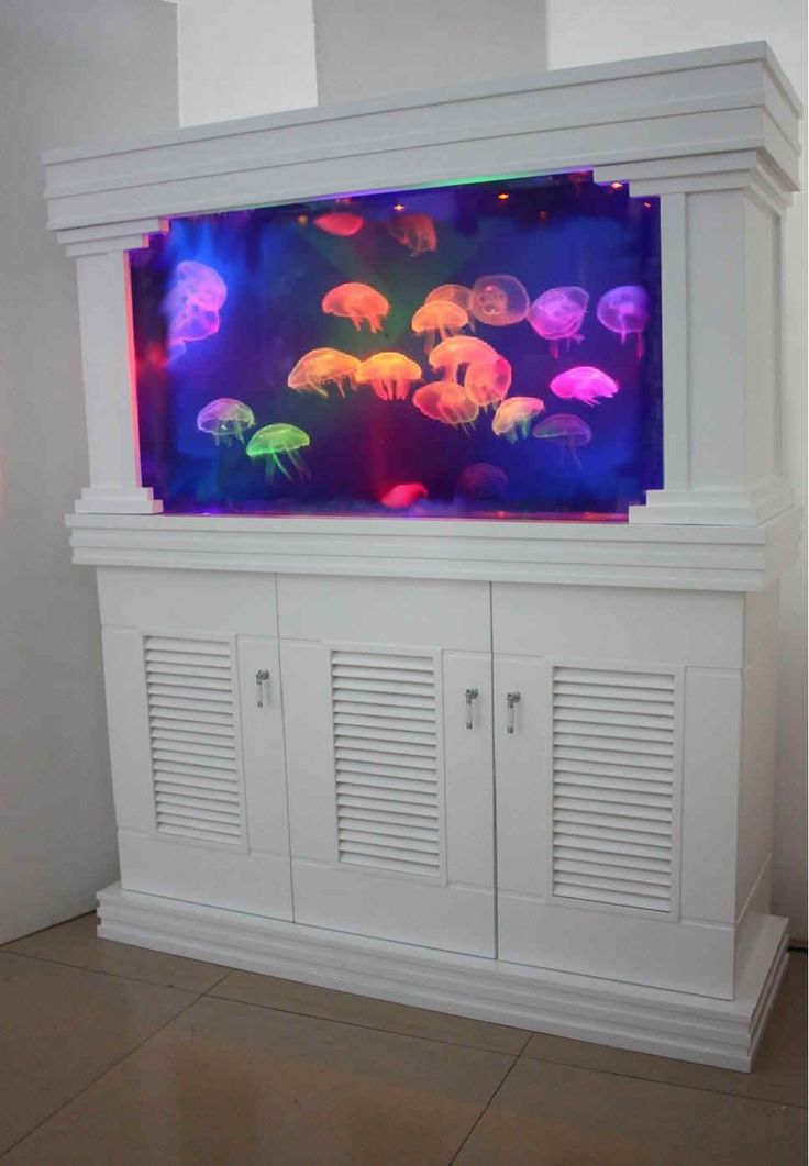 Built in home jelly fish aquarium! How cool!!! This would be awesome in a downstairs game room!!!