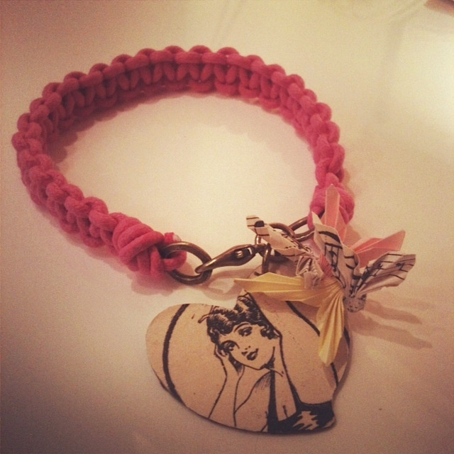 Pink cord wrap bracelet with vintage paper charms. A heart and folded vintage sheet music.   www.justlucy.bigcartel.com