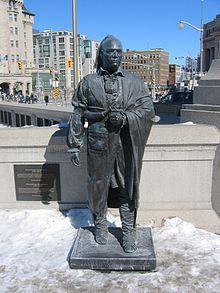 Statue of Joseph Brant at the Valiants Memorial in Ottawa, Ontario. Wikipedia