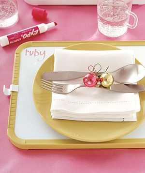 A whiteboard makes a clever charger/place card―not to mention the perfect receptacle for dinnertime doodling.