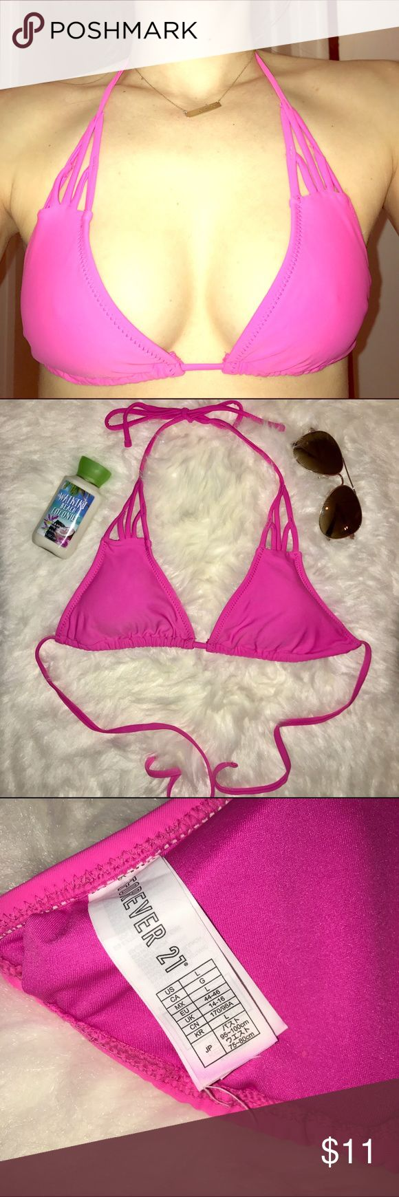 Hot pink bikini top This listing is for the top only! Hot pink bikini top with cute cut outs at the top. From forever 21, perfect condition! Size large, but fits me and I'm a 32c. Forever 21 Swim Bikinis