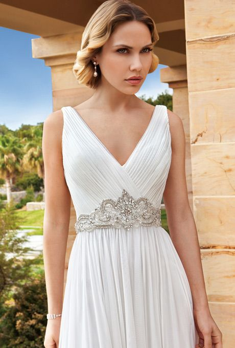 Brides: Demetrios - Destination Romance . Chiffon, A-line gown with a V-neckline and ruched with beaded embellishment on waist. Skirt features a chapel length train.