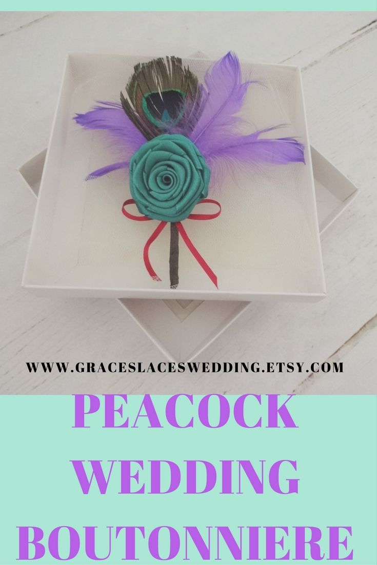 Peacock wedding boutonniere made of satin ribbon rose and feathers #peacockwedding #peacockboutonniere #peacocklapelpin #groomsmenboutonniere #featherboutonniere