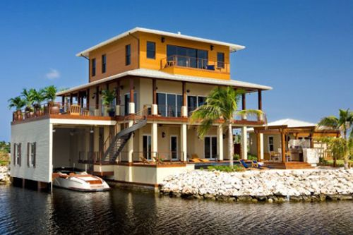 A home in Grand Cayman Islands. Even the boat has a garage. Gotta luv it