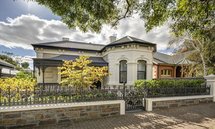 1890 sandstone and bluestone bay window villa. Reading room with walls of built-in bookcases. Modern bathrooms. Marble fire places. Swimming pool. North Adelaide. South Australia. Luxury. Living. InDaily.