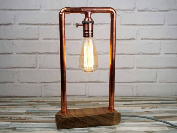 An Edition limited (99 PCs.) and of this iconic and sculptural lamp numbered. Model A  Limited online offer 25% discount: €74.25 / regular price: €99  A wonderful piece of Mongoy and copper tube, solid wood hand made for a completely unique lamp.  All of our products are hand made in our own workshop in Madrid, Spain.  The solid piece of wood of Mongoy has been carefully worked geometrically and sanded to reveal its natural pores. Wood has then been waxed with natural wax that highlights...
